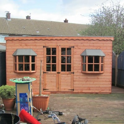 pent summer house with bay windows 1